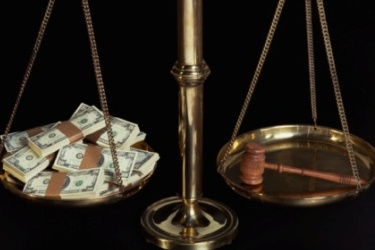 Scale with gavel and money